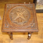 Small aged and carved wood stool